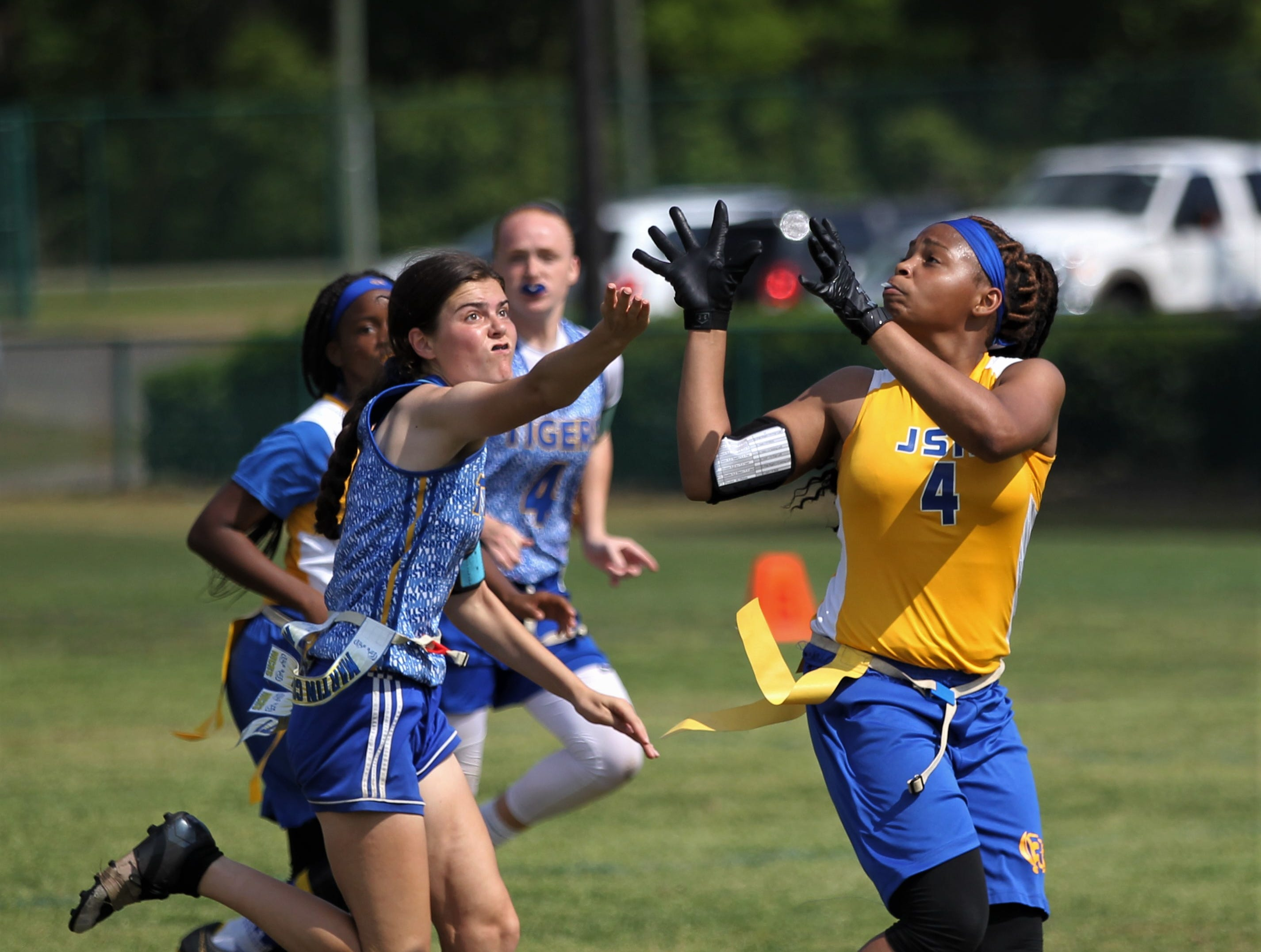 Rickards' Elysia Butler hauls in a deep catch against Martin County in the 2019 Capital City Classic flag football tournament at the FSU Rec SportsPlex on April 6, 2019.