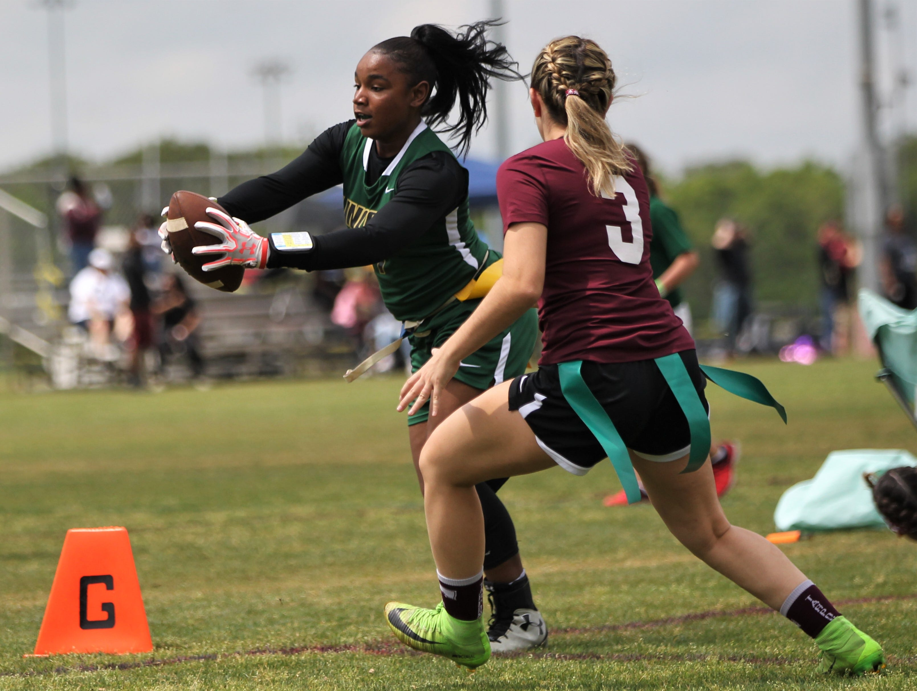 Lincoln's Erin Turral extends for a touchdown against Tarpon Springs in the 2019 Capital City Classic flag football tournament at the FSU Rec SportsPlex on April 6, 2019.