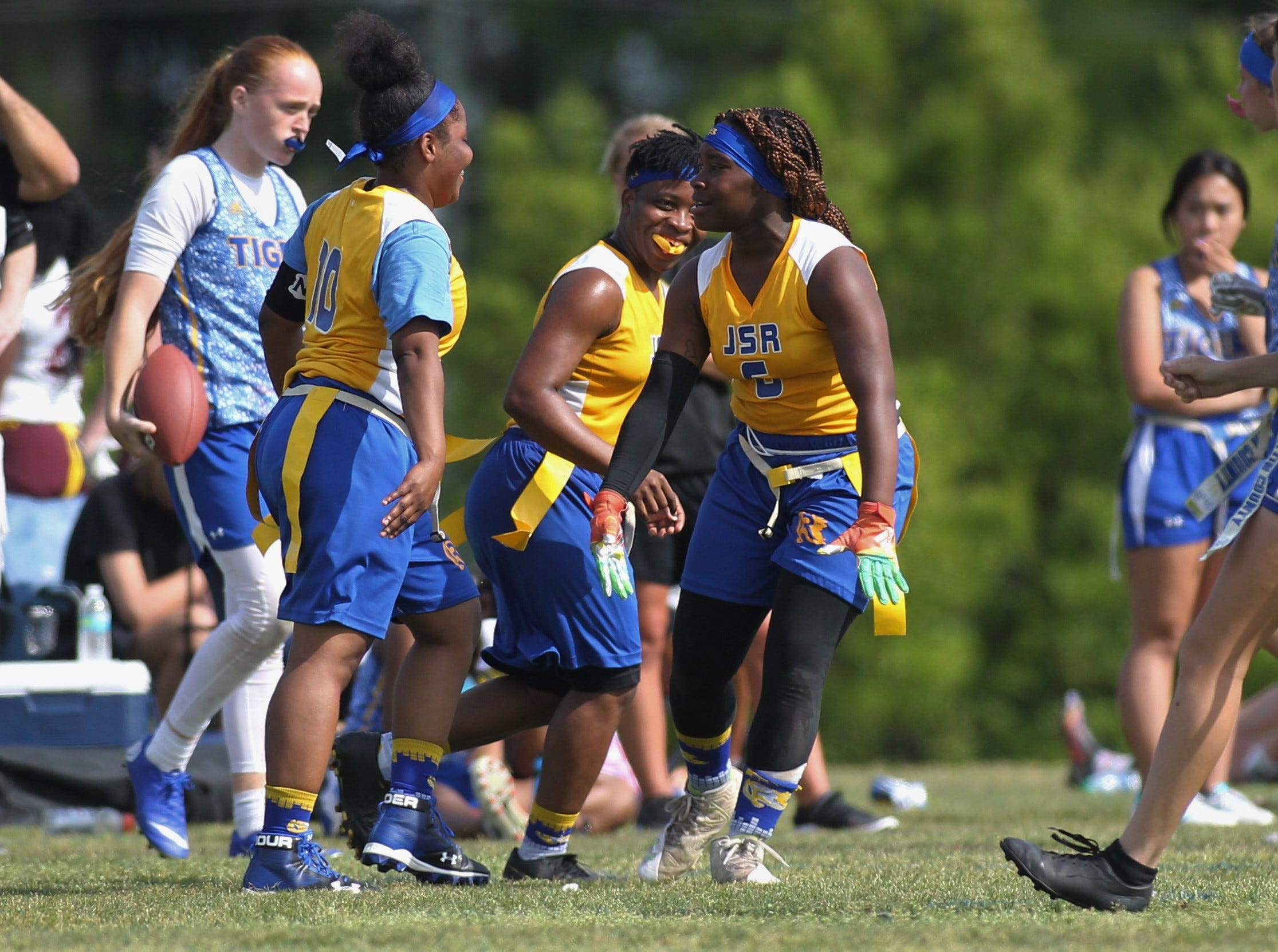 Rickards' Ne'Aysia Randall (10) and Heaven Haynes (6) celbrate a sack during the 2019 Capital City Classic flag football tournament at the FSU Rec SportsPlex on April 6, 2019.