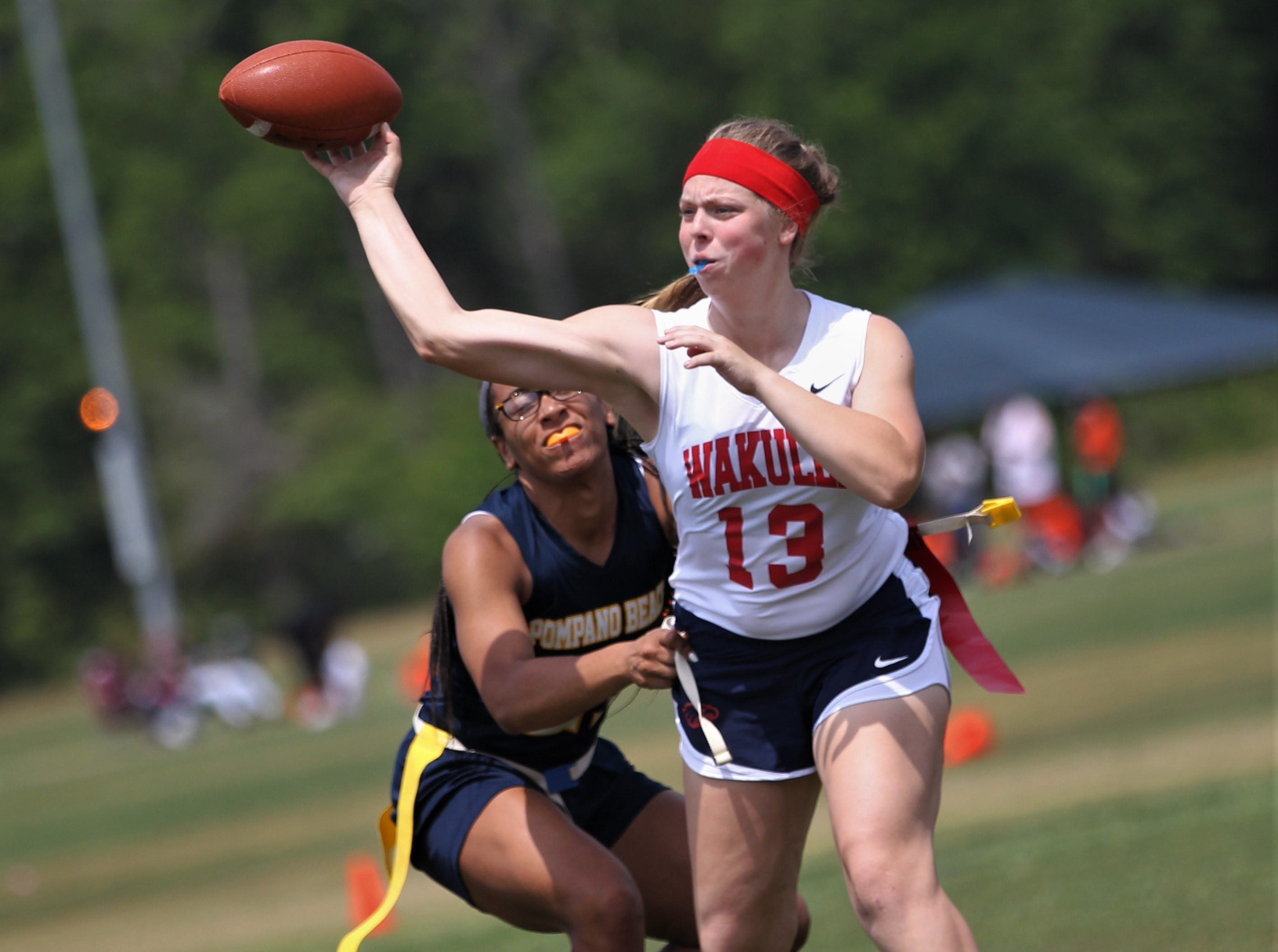 Wakulla quarterback Caitlyn Cason throws a pass against Pompano Beach during the 2019 Capital City Classic flag football tournament at the FSU Rec SportsPlex on April 6, 2019.