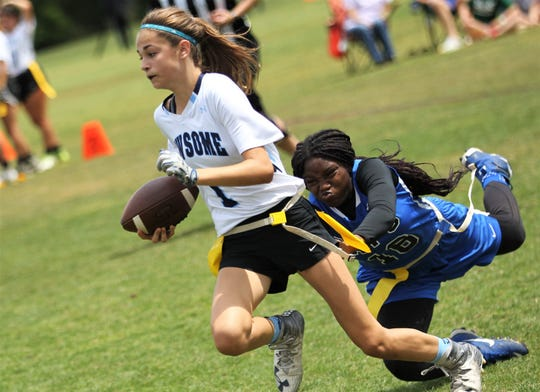 Newsome's quarterback has her flag pulled by Godby's Essence Nobles during the 2019 Capital City Classic flag football tournament at the FSU Rec SportsPlex on April 6, 2019.