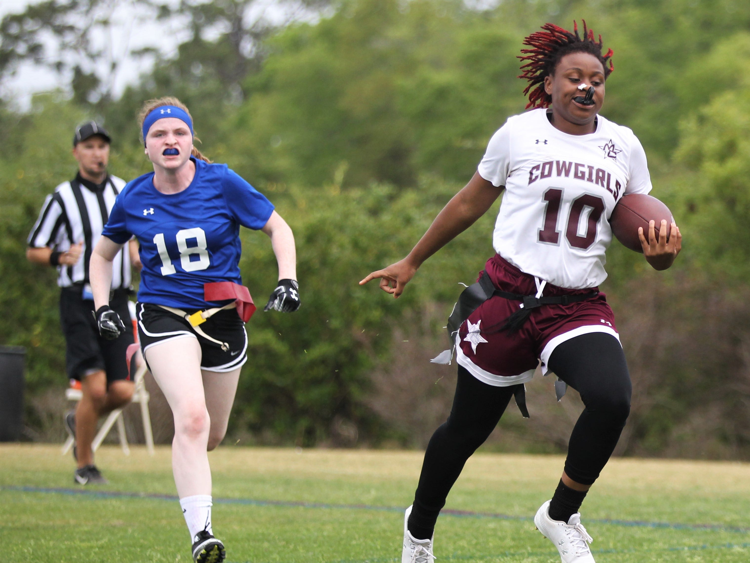 Madison County's Zharia Norwood catches a touchdown pass against Belleview in the 2019 Capital City Classic at the FSU Rec SportsPlex on April 6, 2019.