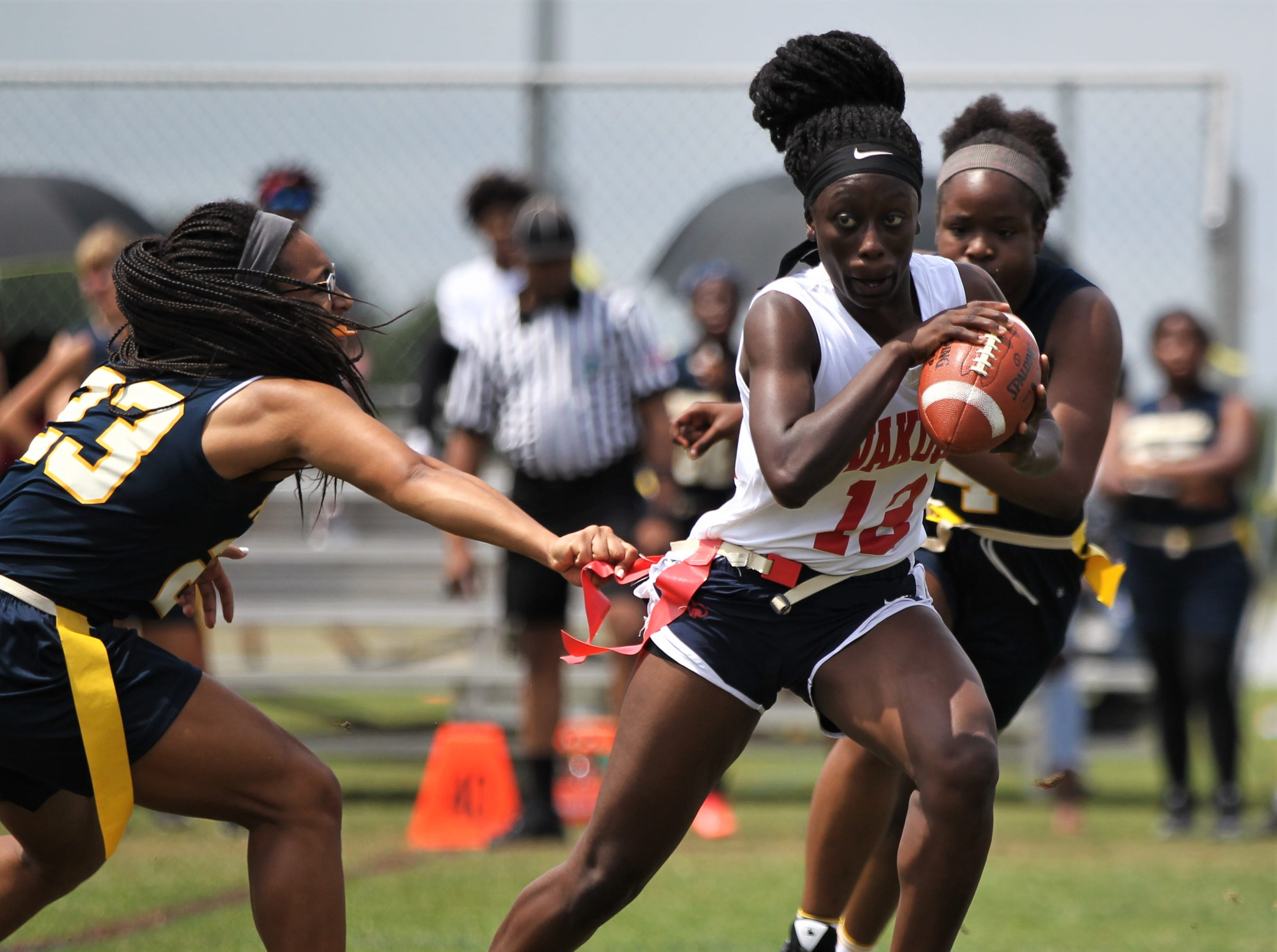Wakulla's Ja'daa Wilson tries to excape a Pompano Beach flag pull in the 2019 Capital City Classic flag football tournament at the FSU Rec SportsPlex on April 6, 2019.