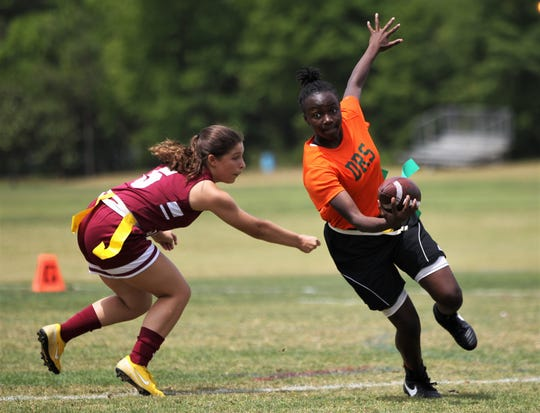 FAMU DRS quarterback Suraya Wash runs for a gain against Pines Charter in the 2019 Capital City Classic flag football tournament at the FSU Rec SportsPlex on April 6, 2019.