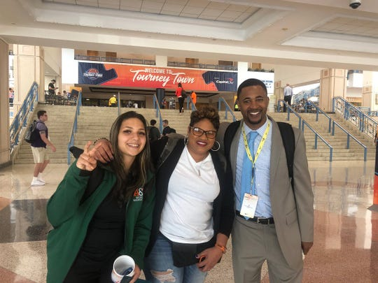FAMU graduate assistant coach Ecenur Yurdakul (left), former Rattler icon Natalie White and women's basketball head coach Kevin Lynum at the women's Final Four in Tampa.