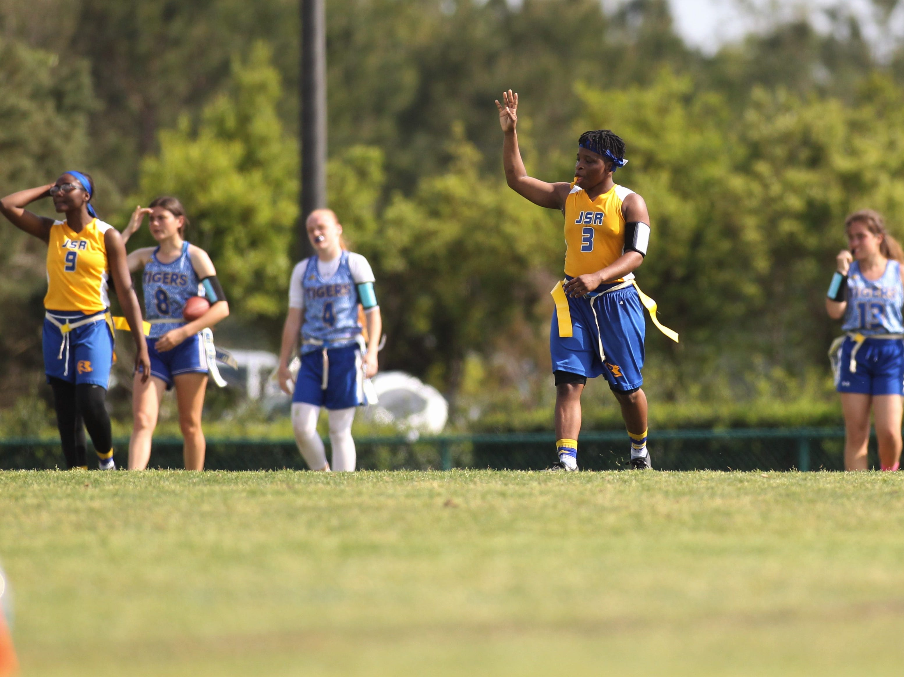 "Rickards senior Iyanla Woodfaulk signals ""fourth quarter"" during the 2019 Capital City Classic flag football tournament at the FSU Rec SportsPlex on April 6, 2019."