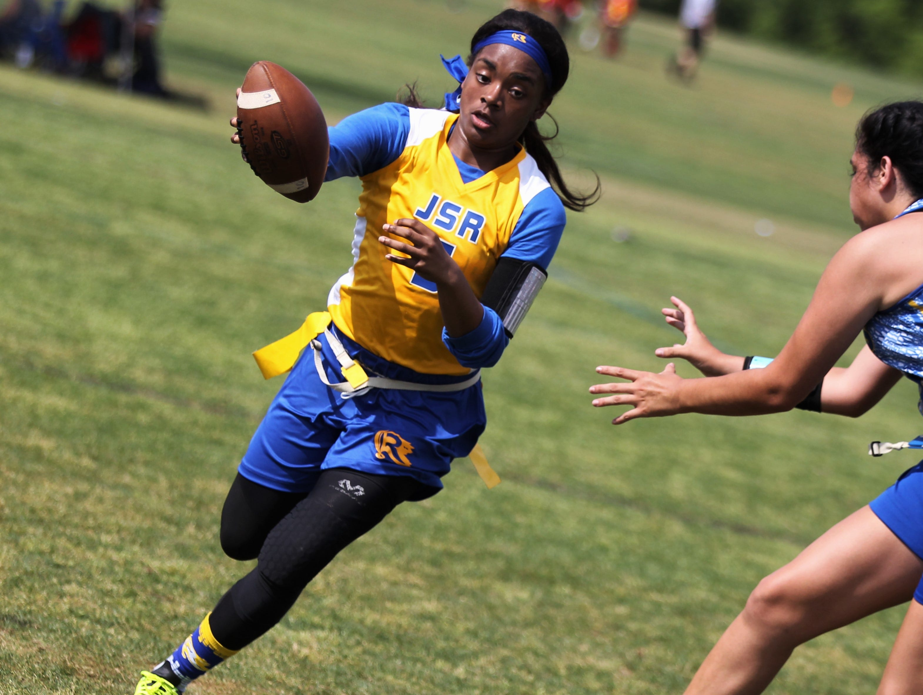 Rickards senior Denia Love runs up field during the 2019 Capital City Classic flag football tournament at the FSU Rec SportsPlex on April 6, 2019.