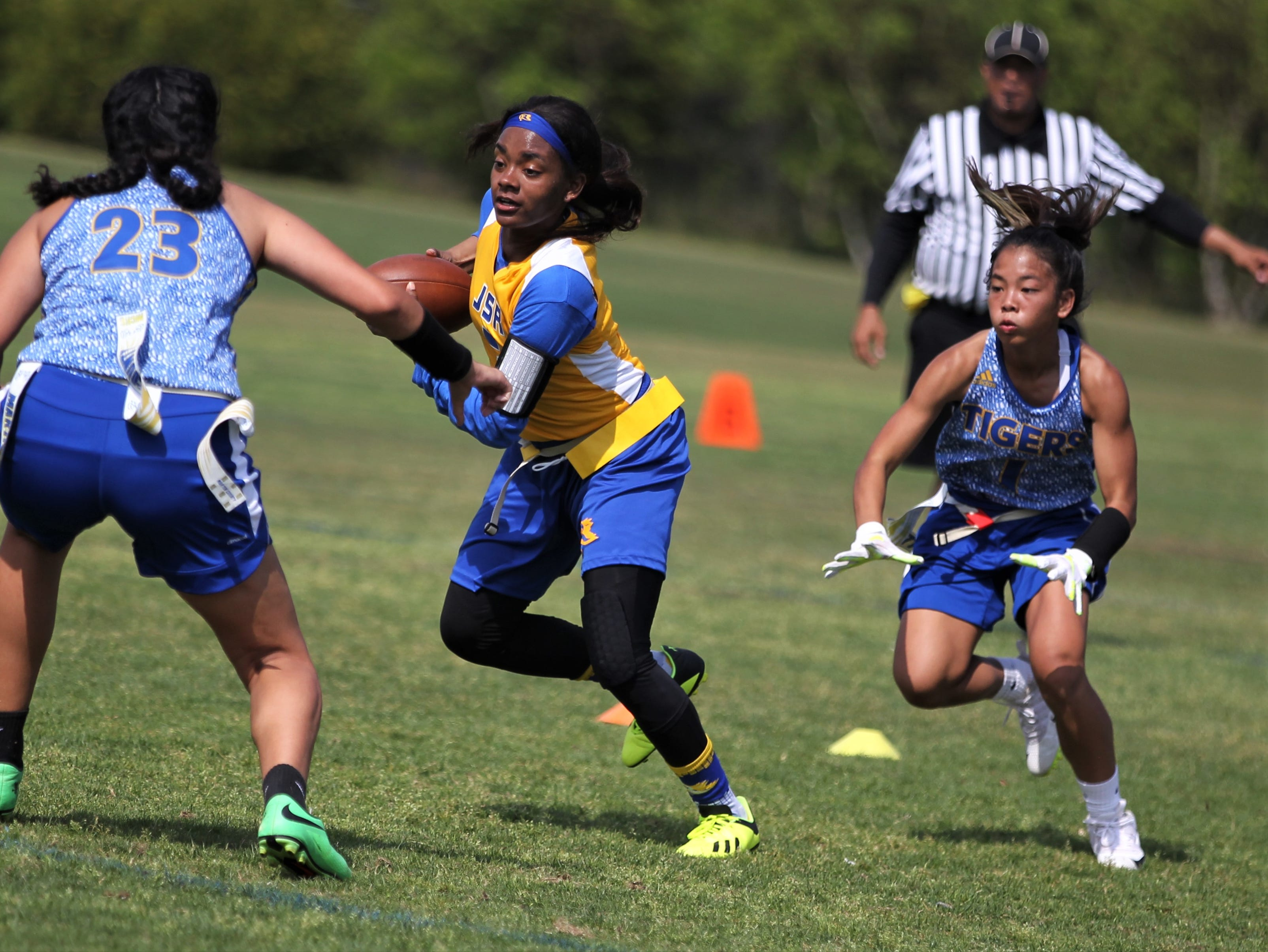 Rickards senior Denia Love runs after a catch during the 2019 Capital City Classic flag football tournament at the FSU Rec SportsPlex on April 6, 2019.