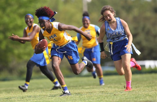 Rickards' Alyssa Gilliam records an interception for a touchdown against Martin County during the 2019 Capital City Classic flag football tournament at the FSU Rec SportsPlex on April 6, 2019.