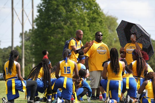 Rickards head coach Tyrell Conyers talks to his team at halftime of the Silver championship during the 2019 Capital City Classic flag football tournament at the FSU Rec SportsPlex on April 6, 2019.