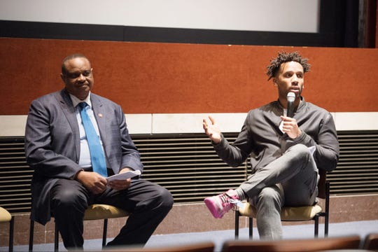 Congressman Al Lawson (left) and Maverick Carter of SpringHill Entertainment field questions from the audience during a panel discussion on the exploitation of student-athletes by the NCAA.
