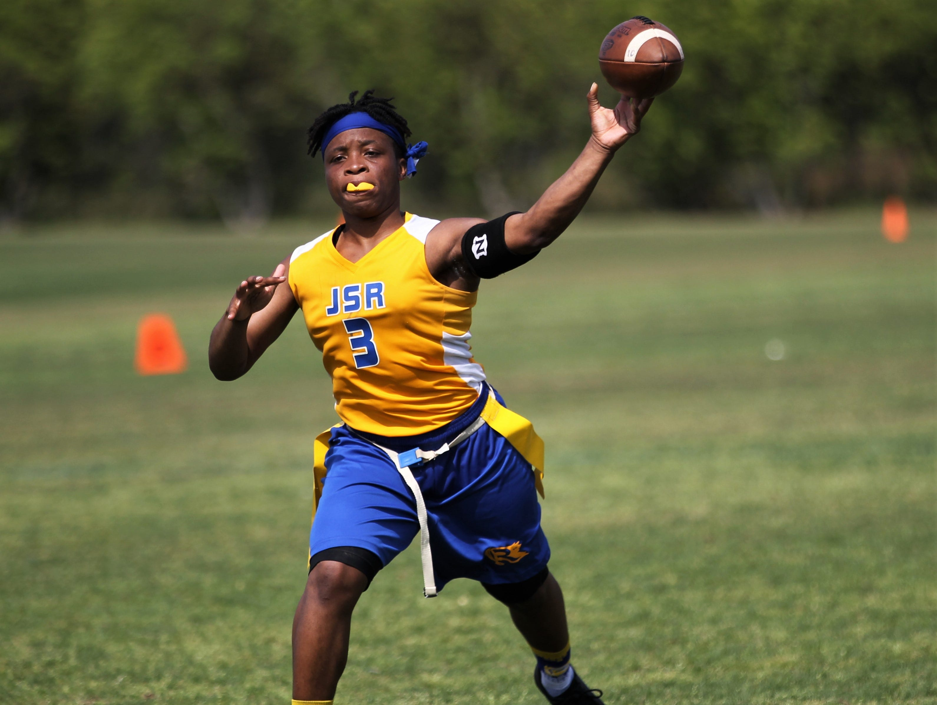 Rickards senior quarterback Iyanla Woodfaulk throws a pass during the 2019 Capital City Classic flag football tournament at the FSU Rec SportsPlex on April 6, 2019.