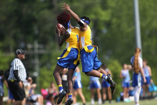 Rickards' Iyanla Woodfaulk (3) celebrates a pick six by Alyssa Gilliam (1) during the 2019 Capital City Classic flag football tournament at the FSU Rec SportsPlex on April 6, 2019.