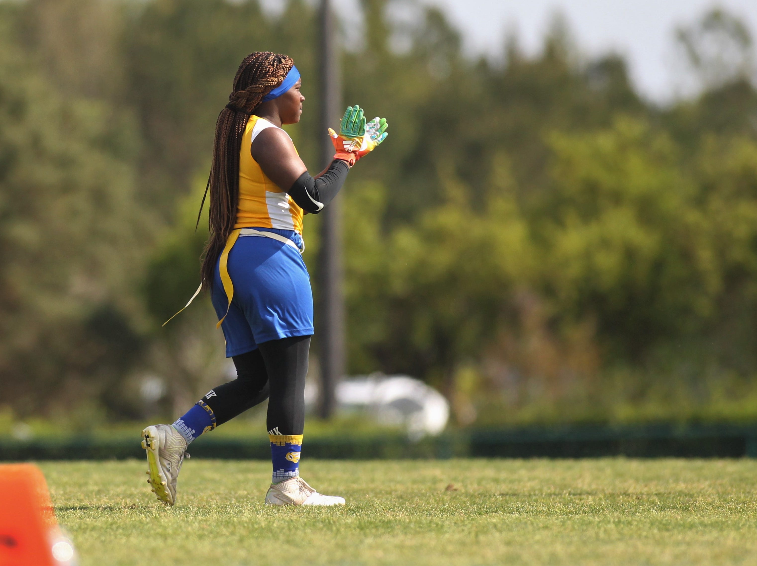 Rickards' Heaven Haynes claps after a big play in the 2019 Capital City Classic flag football tournament at the FSU Rec SportsPlex on April 6, 2019.