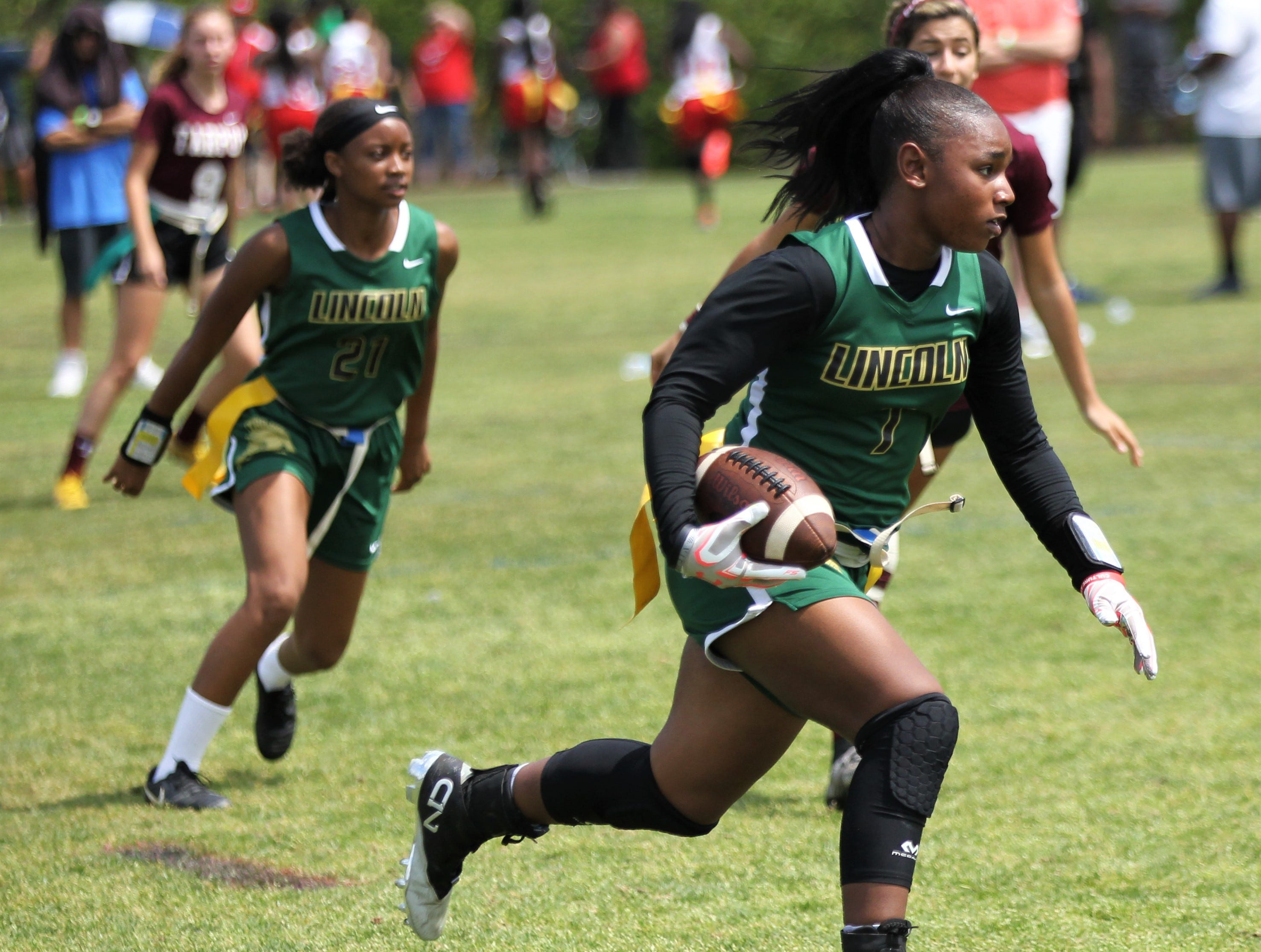 Lincoln's Erin Turral runs for a long touchdown against Tarpon Springs in the 2019 Capital City Classic flag football tournament at the FSU Rec SportsPlex on April 6, 2019.
