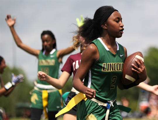 Lincoln junior Malia Burch scores a touchdown against Tarpon Springs in the 2019 Capital City Classic flag football tournament at the FSU Rec SportsPlex on April 6, 2019.