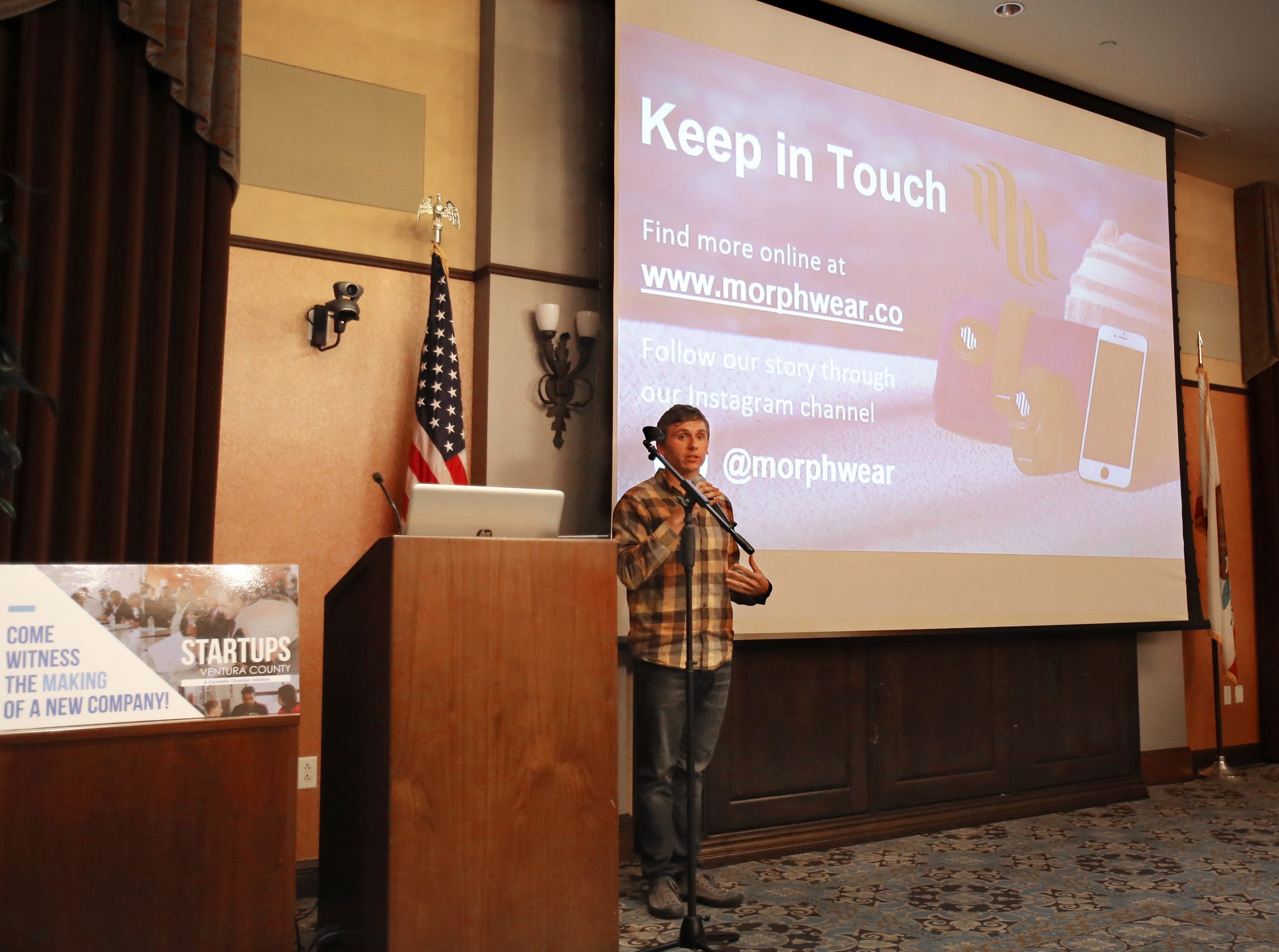 Konrad Antoniuk, from Morphwear, talks about his company during the Startups Ventura County event at the Camarillo Public Library. His company is working on a device that will enable swimmers to track their performance while working out in the pool. Entrepreneurs were competing for the top prize of $10,000 during the three-day event that started Friday.