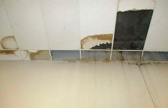In this undated photo provided by the Prison Law Office, a nonprofit public interest law firm that provides free legal services to prison inmates, are the front wall and ceiling of a dining hall where damaged ceiling tiles have been removed at the California Substance Abuse Treatment Facility and State Prison in Corcoran.