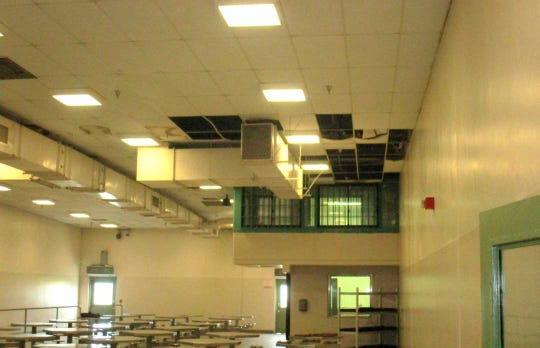 In this undated photo provided by the Prison Law Office, a nonprofit public interest law firm that provides free legal services to prison inmates, is a dining hall where damaged ceiling tiles have been removed at the California Substance Abuse Treatment Facility and State Prison in Corcoran. California is spending $260 million over four years to repair leaking roofs and clear dangerous mold that imperils more than two dozen deteriorating prisons. An inmate lawsuit over the conditions says the repairs aren't moving fast enough.