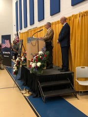Ben Pilla, father of Sgt. Dominick Pilla, addresses the hundreds of people at the school dedication ceremony.