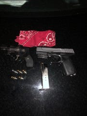 Visalia police found loaded firearms on two known gang members.