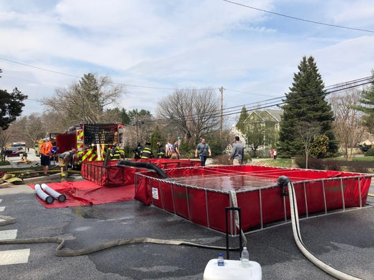 Water was brought in by tankers and put in these containers to fight a fire on Chandler Lane in Centreville Sunday.