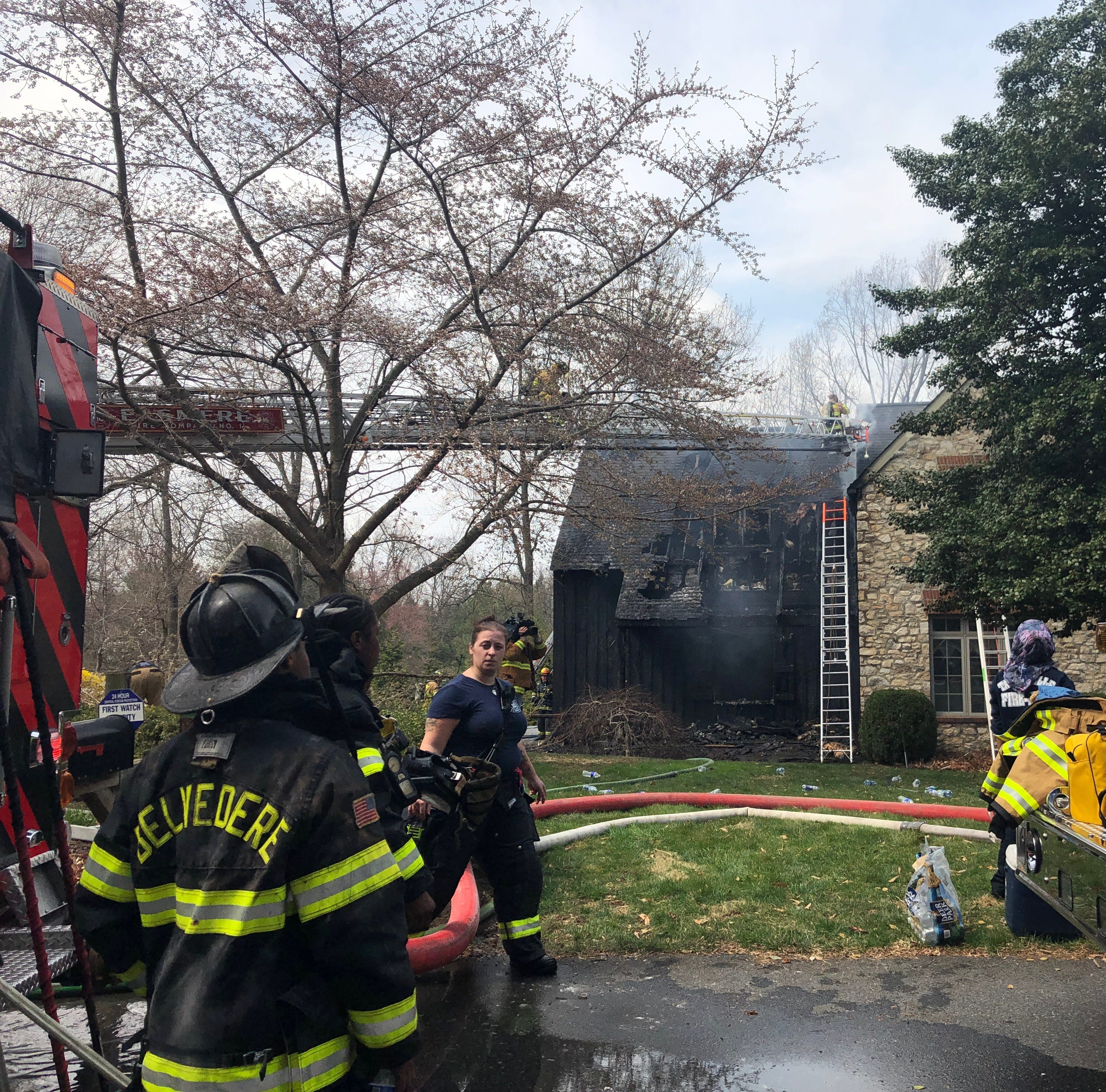 Firefighters at scene of house fire on Chandler Avenue in Centreville