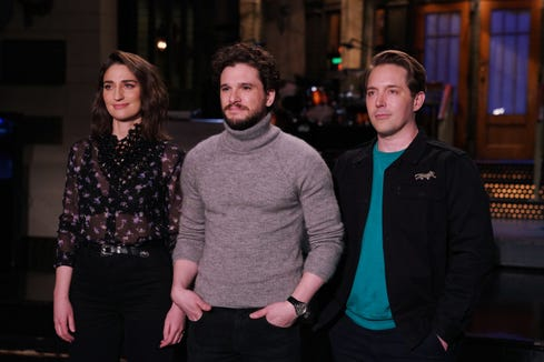 "Kit Harington (center) hosts ""Saturday Night Live"" on April 6, 2019, with musical guest Sara Bareilles (left)."