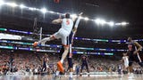 SportsPulse:  A controversial foul call played a pivotal role in Virginia beating Auburn in the Final Four and both teams voiced their opinions on it after the game.