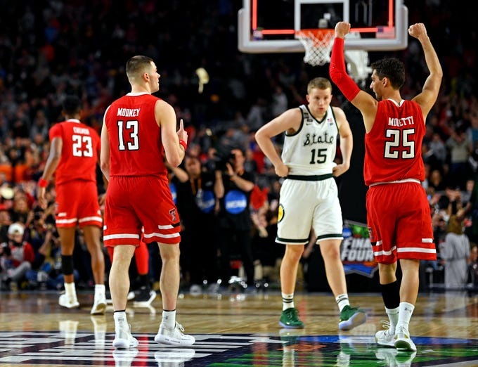 Texas Tech Red Raiders guards Matt Mooney (13) and Davide Moretti (25) celebrate after beating the Michigan State Spartans.