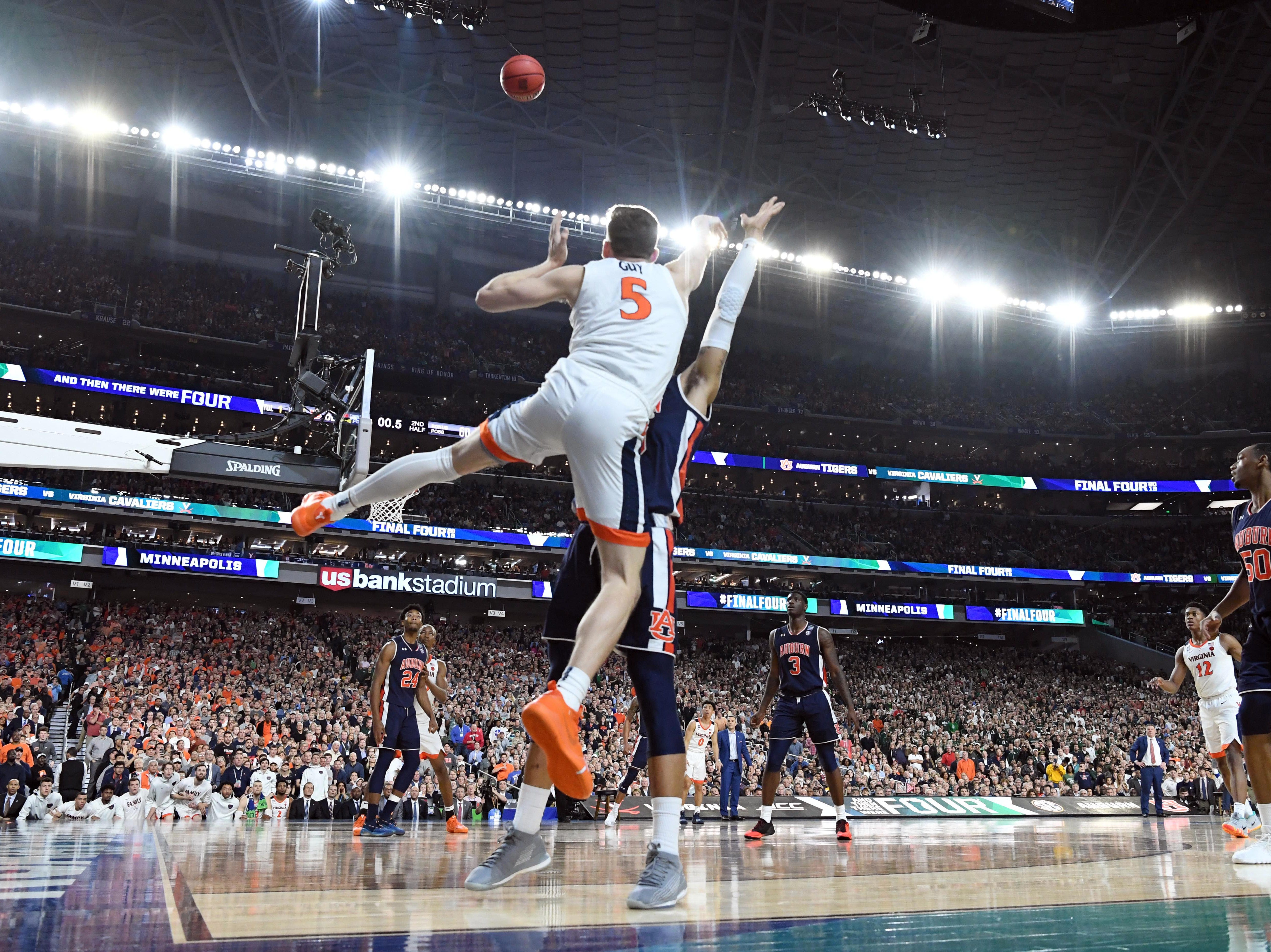 Virginia Cavaliers guard Kyle Guy (5) is fouled on a 3-pointer in the final seconds against the Auburn Tigers.