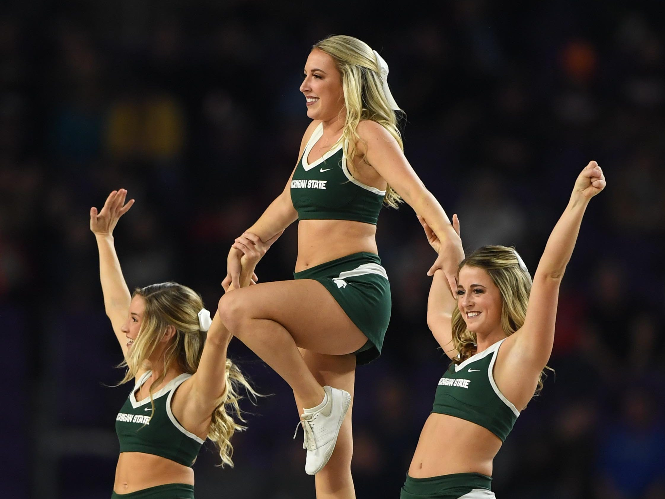 Final Four: Michigan State Spartans cheerleaders perform during the game against the Texas Tech Red Raiders.