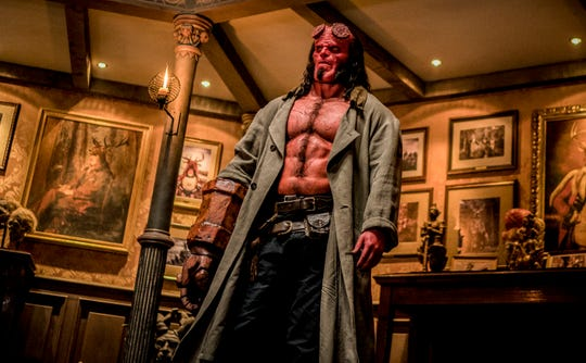"Hellboy (David Harbour) and his Right Hand of Doom are ready to beat down some monsters in ""Hellboy."""
