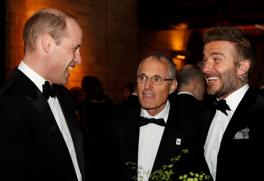 "Prince William, left, speaks with David Beckham, right, prior to the ""Our Planet"" global premiere at the Natural History Museum on April 4, 2019, in London."
