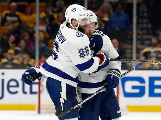 Lightning center Tyler Johnson holds the puck for right wing Nikita Kucherov, who assisted on the goal to set the record for most points scored in one season by a Russian born player (128 points).
