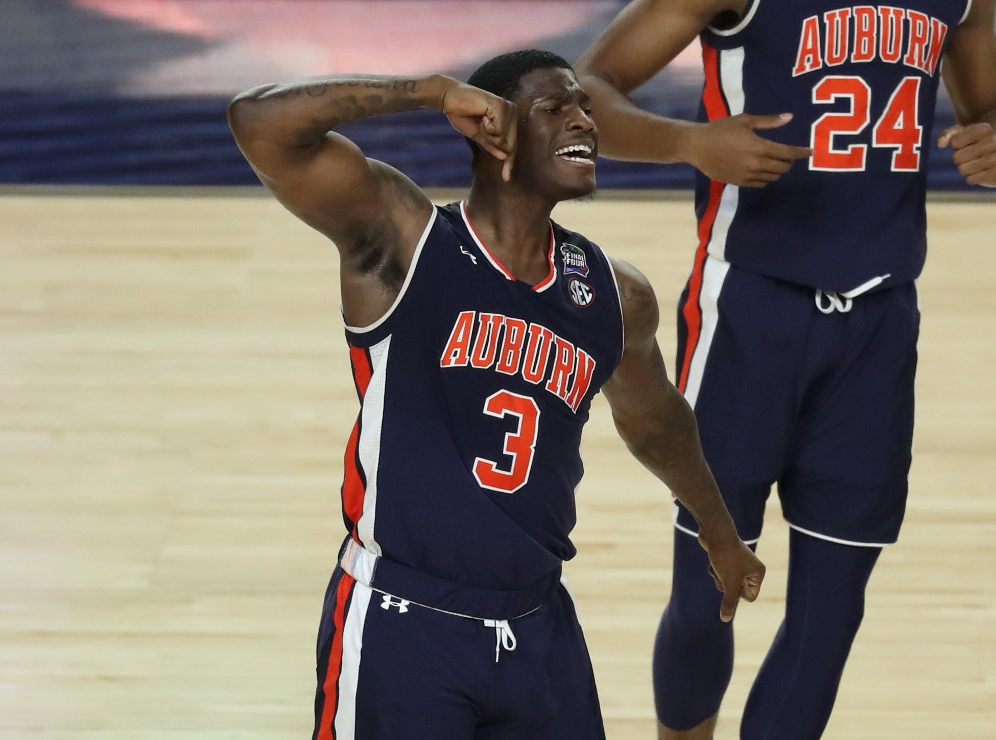 Auburn Tigers forward Danjel Purifoy (3) celebrates during the second half against the Virginia Cavaliers.