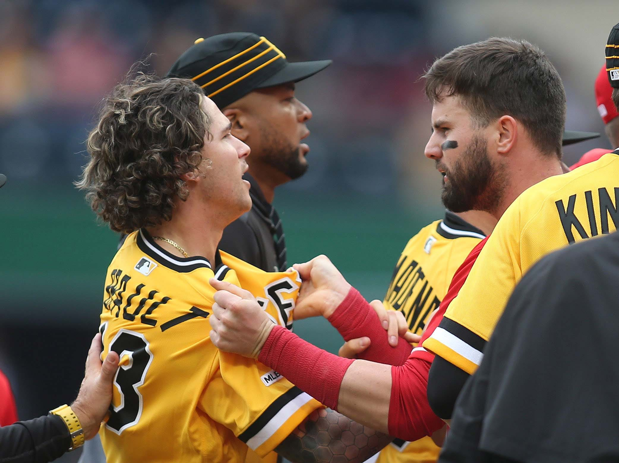 April 7: Pittsburgh Pirates relief pitcher Steven Brault (43) and Cincinnati Reds left fielder Jesse Winker argue after benches cleared during the fourth inning at PNC Park.