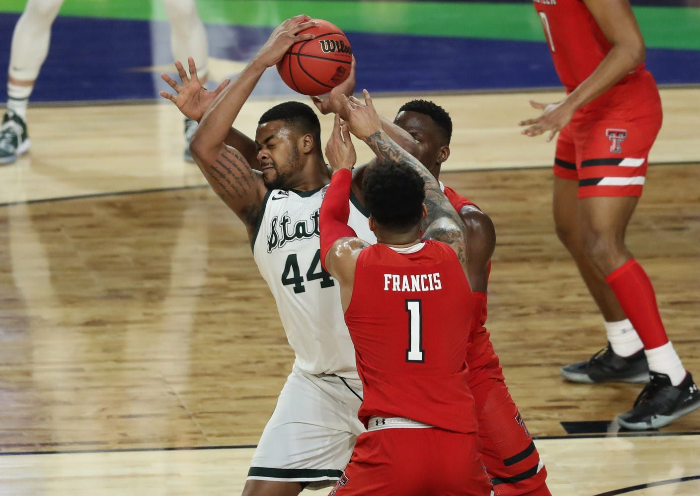 Texas Tech defenders sward Nick Ward during the national semifinals of the 2019 Final Four.