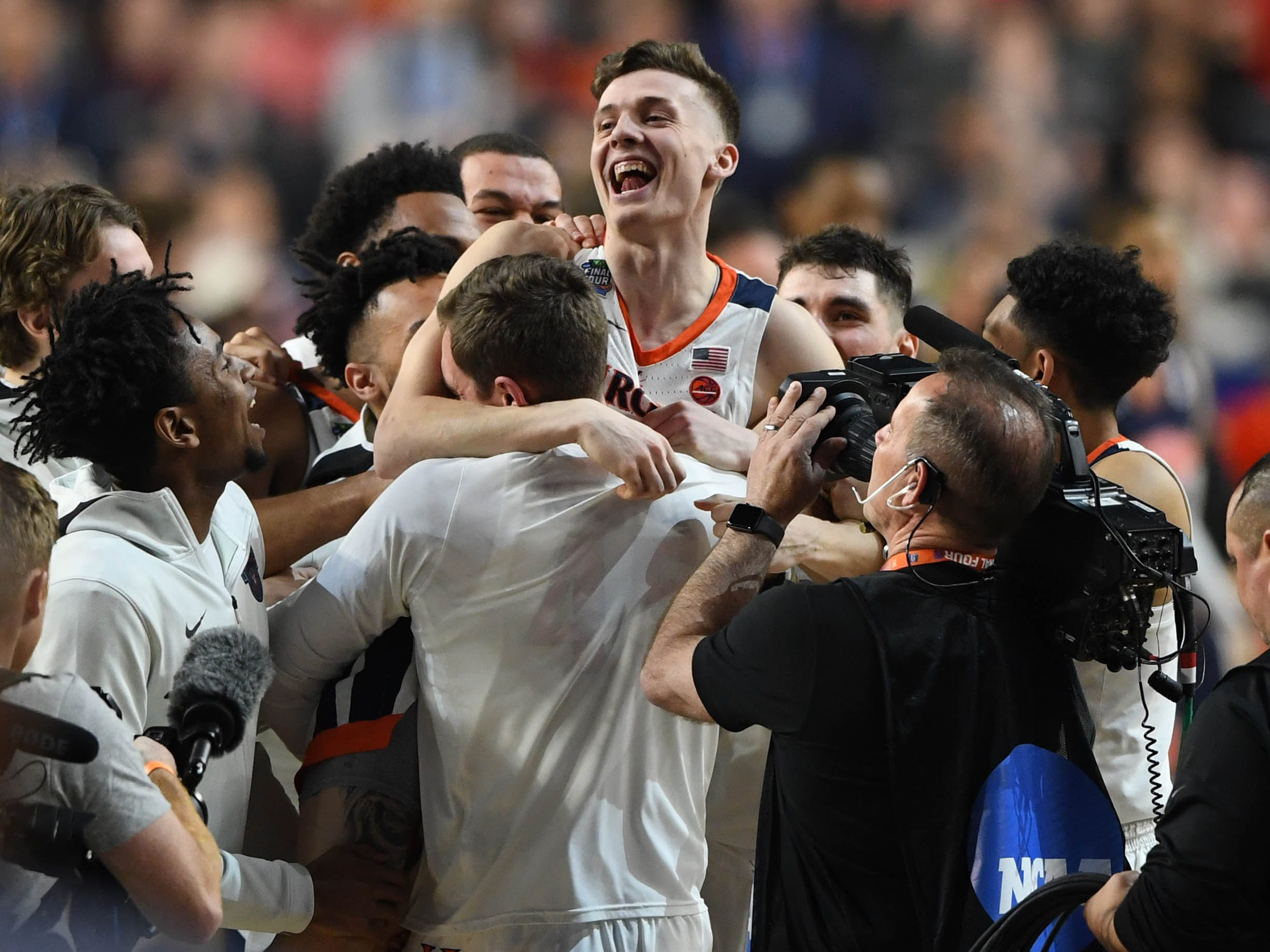 Virginia Cavaliers guard Kyle Guy celebrates after defeating the Auburn Tigers in their Final Four game.