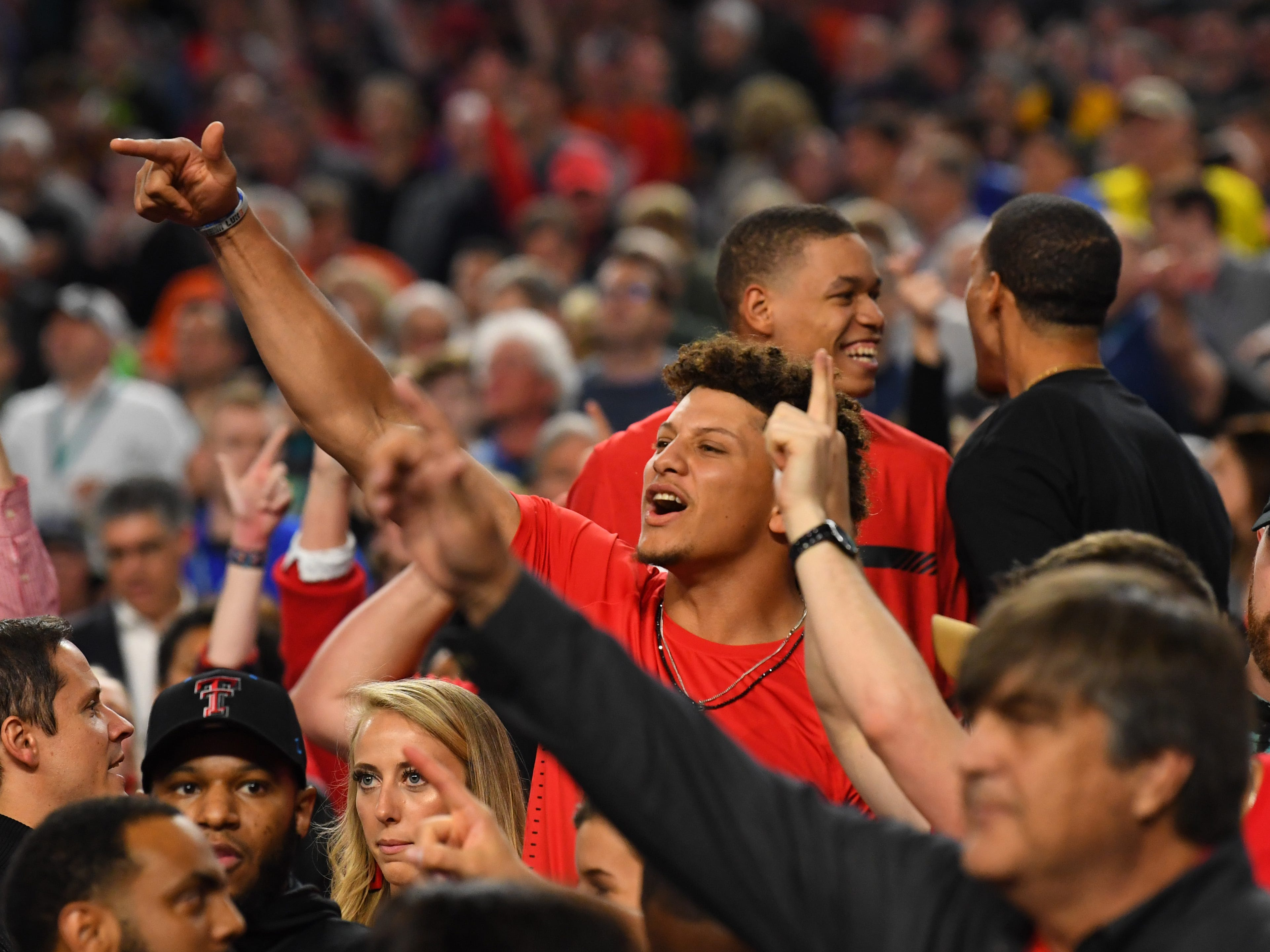 Final Four: Kansas City Chiefs quarterback and former Texas Tech football player Patrick Mahomes cheers in the stands during the Red Raiders' game against the Michigan State Spartans.
