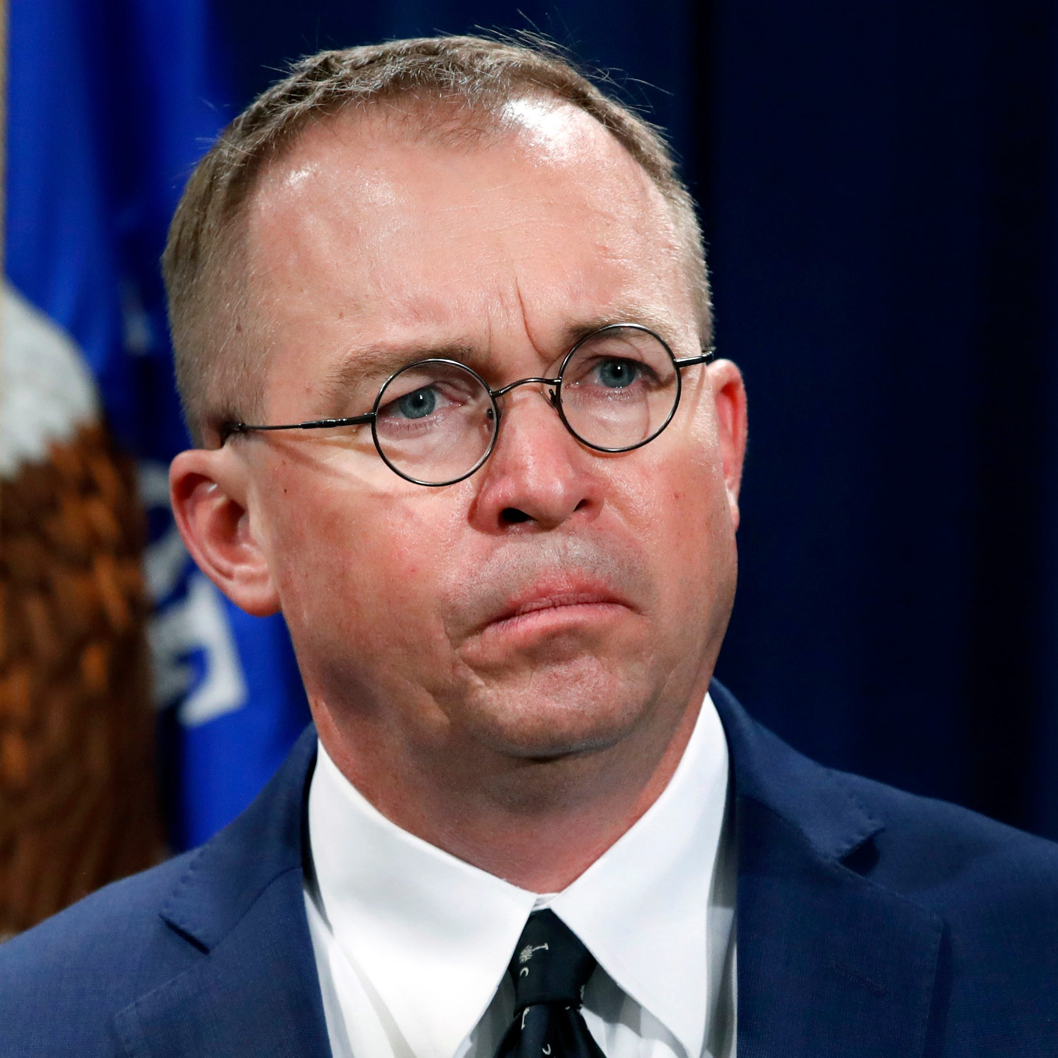 Mick Mulvaney  listens during a news conference at the Department of Justice in Washington on July 11, 2018.
