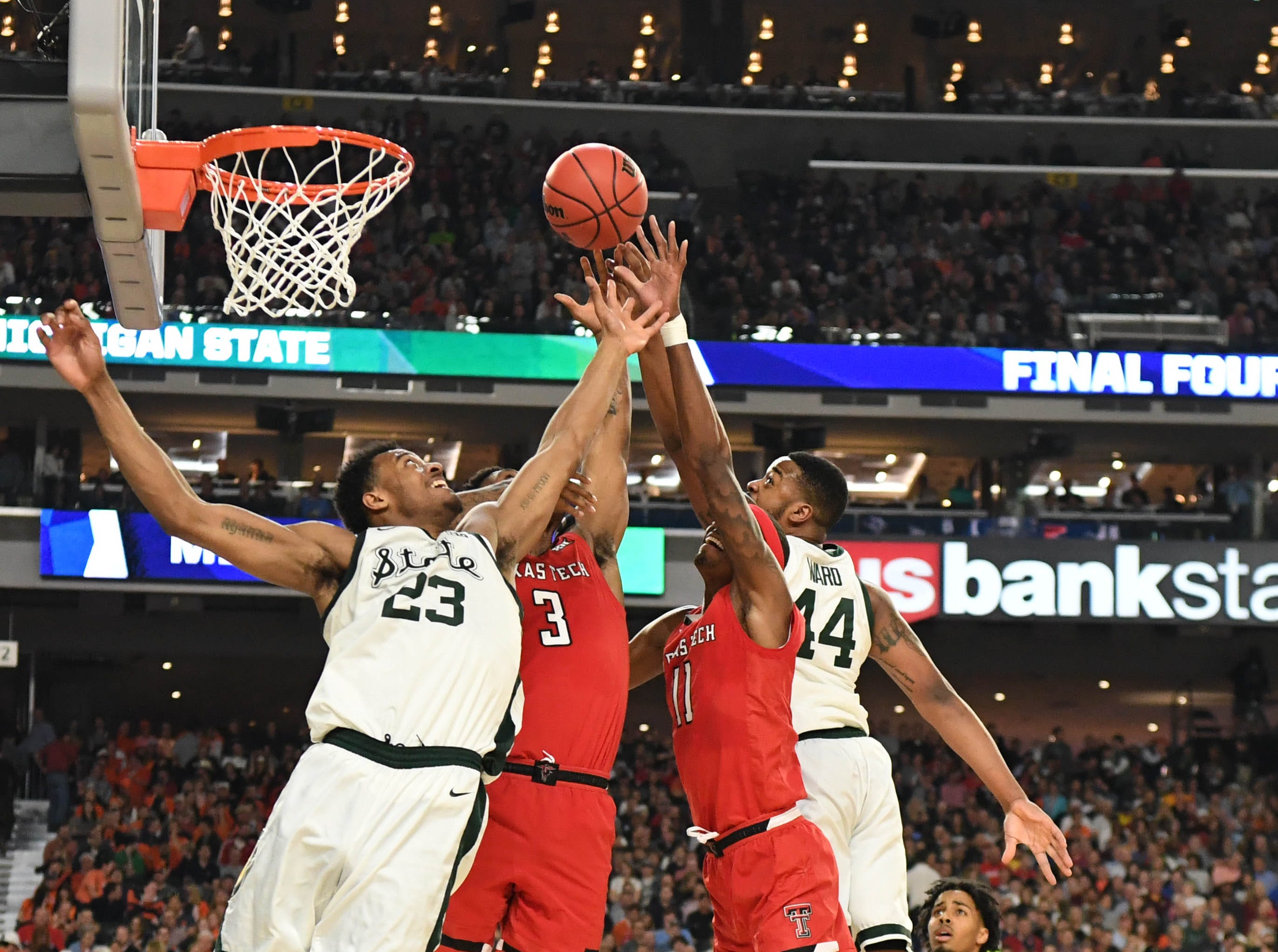 Michigan State Spartans forwards Xavier Tillman (23) and Nick Ward (44) go for a rebound with Texas Tech Red Raiders forwards Deshawn Corprew (3) and Tariq Owens (11).