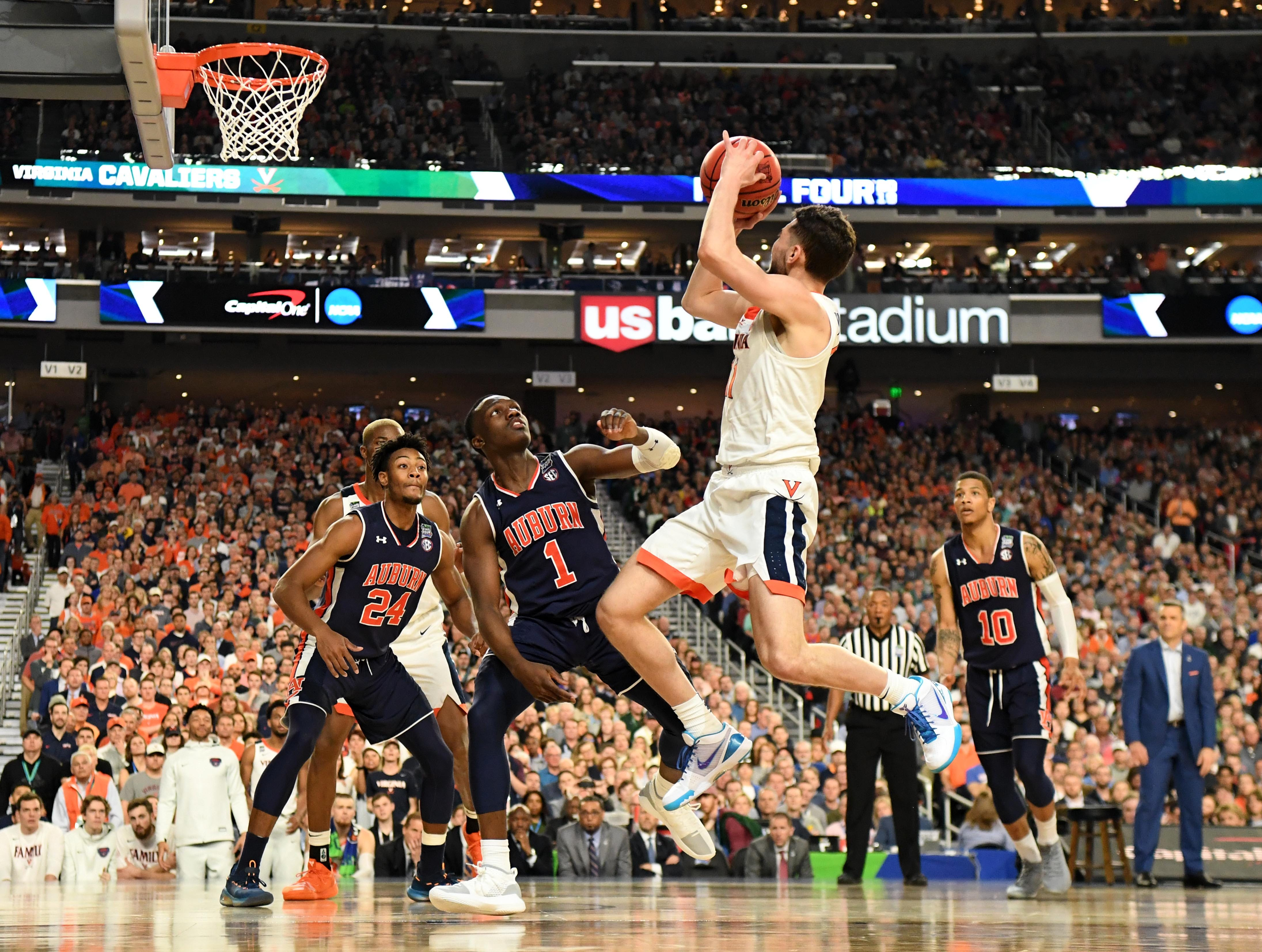 Virginia Cavaliers guard Ty Jerome (11) shoots against Auburn Tigers guard Jared Harper (1).