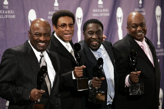 A more recent lineup of The O'Jays (from left, Walter Williams, Sammy Strain, Eddie Levert and Bobby Massey) pose for backstage after being inducted into the Rock and Roll Hall of Fame in 2005. Bill Isles, one of the group's co-founders, has died at 78.