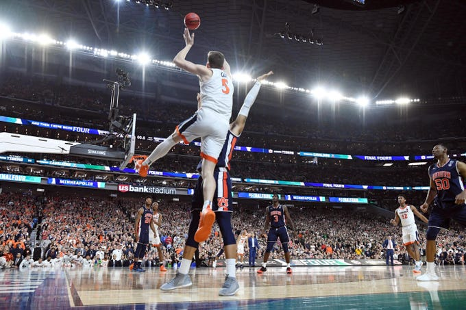 Virginia Cavaliers guard Kyle Guy (5) is fouled on a 3-point shot in the final seconds against the Auburn Tigers.