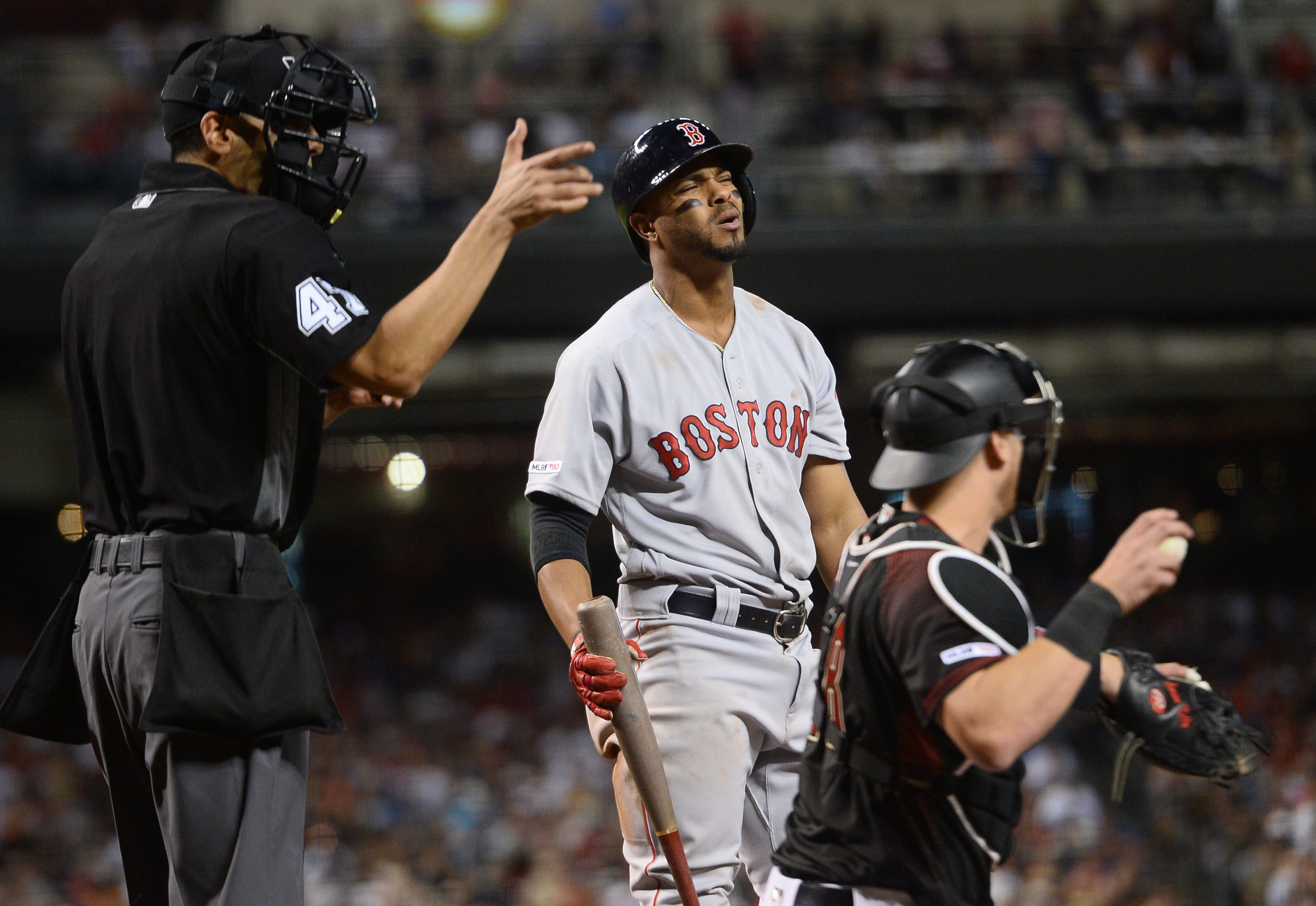 Xander Bogaerts reacts to a called third strike during Saturday's loss in Arizona.