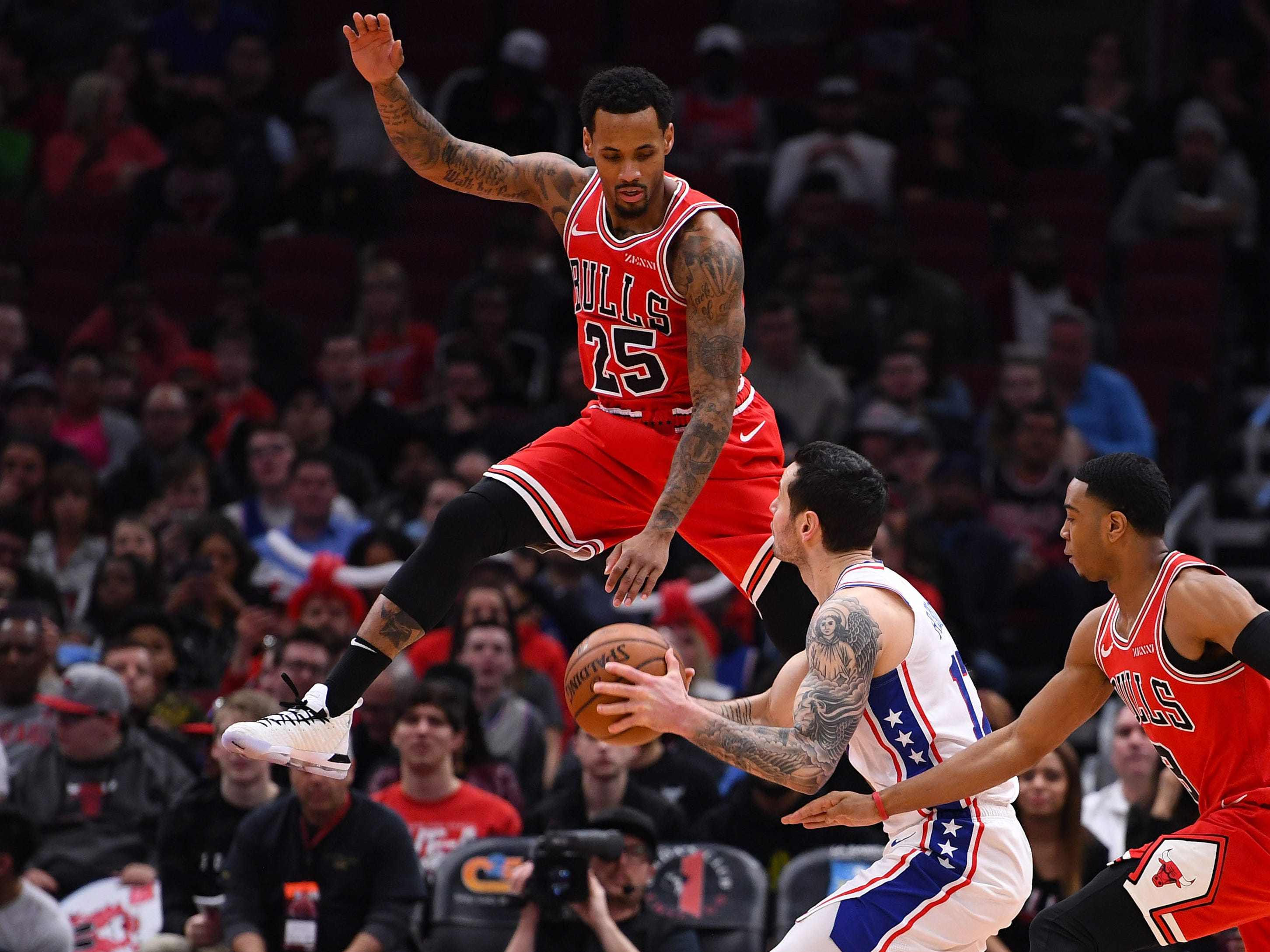 April 6: Sixers guard J.J. Redick (17) gets Bulls defender Walt Lemon Jr. (25) up in the air with a ball fake during the first half in Chicago.
