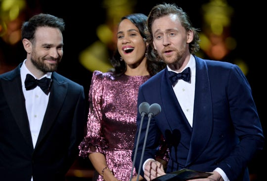 Charlie Cox, Zawe Ashton and Tom Hiddleston present the best actress award at The Olivier Awards 2019 at the Royal Albert Hall in London.