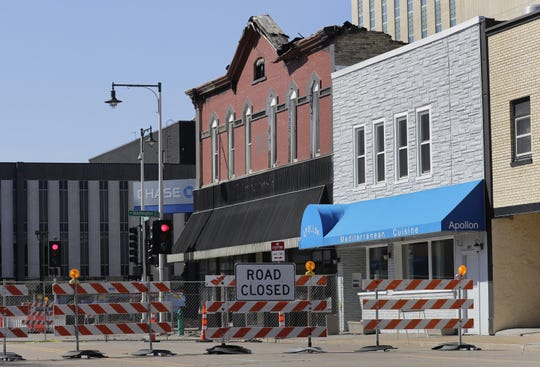 The Apollon restaurant at 207 N. Appleton St. is back in business in downtown Appleton. Apollon is the building with the blue awning. The red brick building next door, which housed Author's Kitchen + Bar, was gutted by fire March 13 and will be razed.