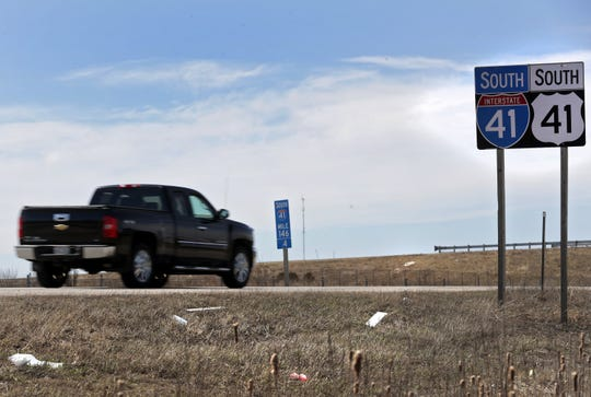 Litter lies along the edge of southbound Interstate 41 in Little Chute.